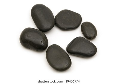 black stones on white background