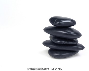 Black stones stacked over white background (clipping path included)