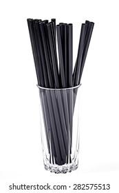 Black straws isolated on white background.