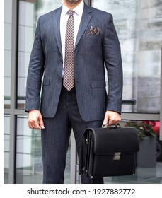 black striped man suit combined on a live mannequin hand bag business man great squares fashion trend men's clothing textile world fashion outdoor shooting buying.