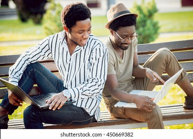 Black students in the park. Beautiful background.