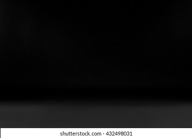 Black studio background. Copy space