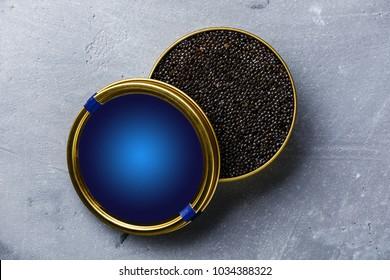 Black Sturgeon caviar in can on concrete background