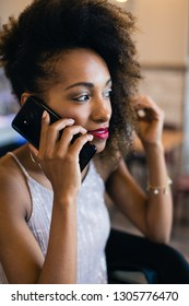 Black stylish woman on a cell phone call.