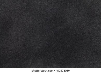 Black suede fabric closeup. Velvet texture background