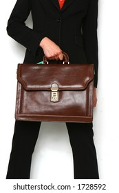 black suit woman with brown bag