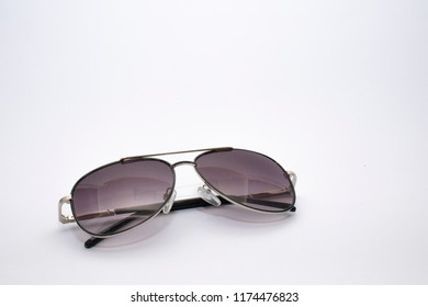Black sunglases on a white background