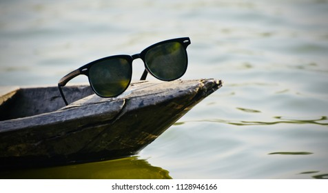 A black sunglass kept on the parts of a boat isolated unique photograph
