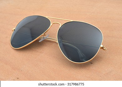 black sunglasses isolated on a wood background