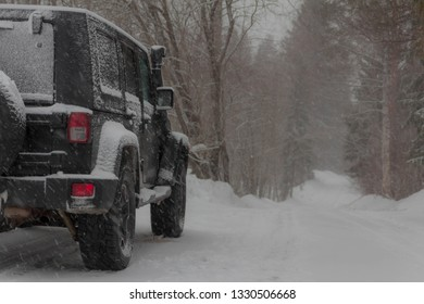 black SUV on winter road