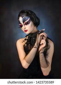 Black Swan. The girl in the image of a black swan. Swan Lake. Beautiful girl in black.