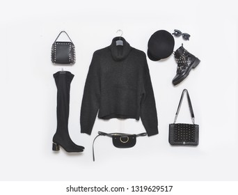 Black sweater with black boots ,sunglasses, handbag,sunglasses,hat isolated