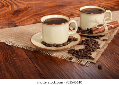 black sweet coffee in brown cups with vanilla cane and anise flower
