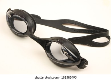black swimming goggles in casecloseup  isolated on white background
