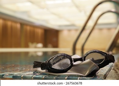 Black Swimming Sport Goggles on the Swimming poolside.