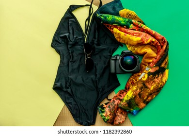 black swimsuit with green and yellow background in allusion to the Brazilian flag