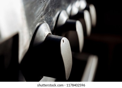 Black switches in row on the stove close-up. Closeup Of Knobs Switch Of Gas Stove. Control knobs selective focus