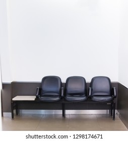 Black synthetic leather bench seat row on white color wall background. Interior Architecture, House or Office Furniture, Life and Living, Layout, Lifestyle, Decoration and Minimal Design Idea concept