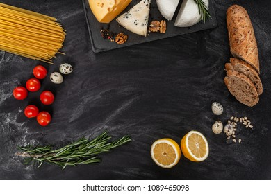 Black table with different food, farm products, top view, frame for text.