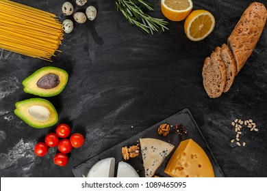 Black table with different food, natural farm products, top view, frame for text