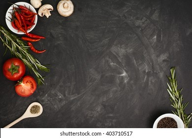 Black table with food ingredients and utensil, top view frame style