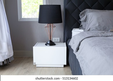 black table lamp with grey bedding style