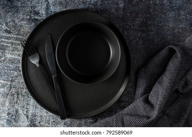 Black table setting a new style with napkin
