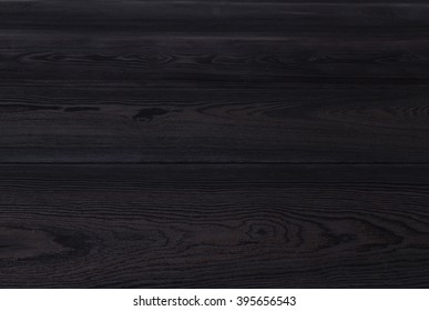 black table top with rough wooden texture. Vintage background