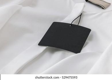 Black Tag on White Blouse