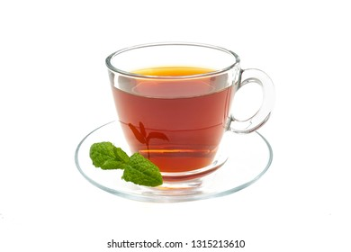 Black tea with ginger in a cup on a white background