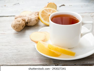 black tea with ginger and a lemon