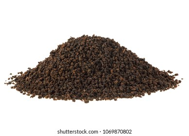 Black tea granules on a white background