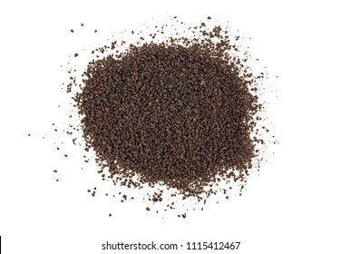 Black tea granules on a white background. Top view.