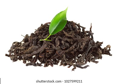 Black tea with green leaf isolated on white background