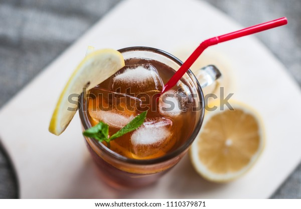 black tea with ice, with lemon and mint on the table