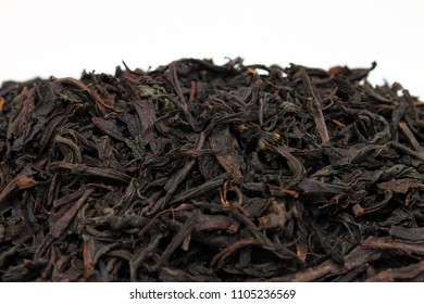 black tea isolated on white background - close-up macro black tea.