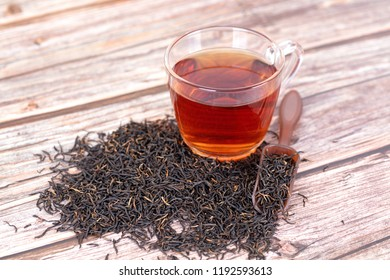 Black tea leaves and a cup of tea
