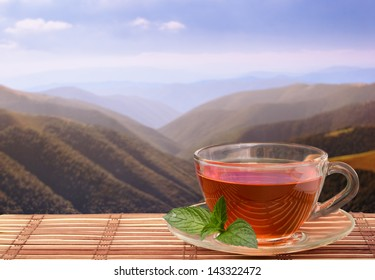 Black tea with pepper mint on frash air in mountains