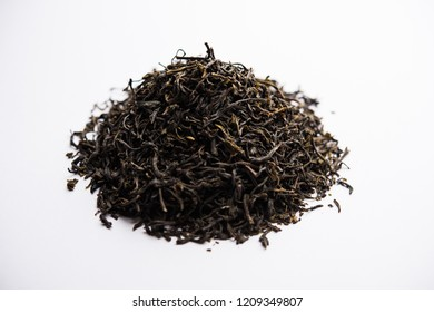Black Tea Powder or dry dust with or without green leaf and served hot chai in a cup