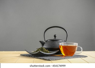 Black tea set on wooden table