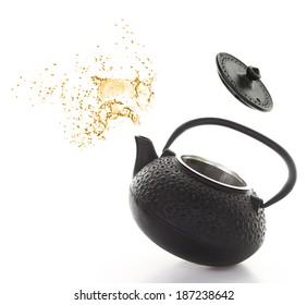 Black teapot with tea splash isolated on white background