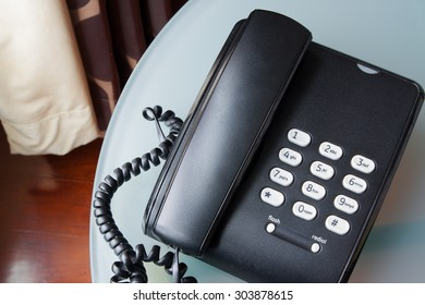 black telephone on a table