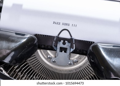 Black text Fake News written on an old retro typewriter