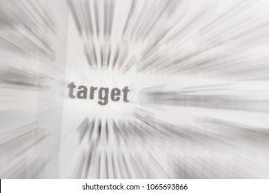 "Black text on white background. Focus ""target"" and radial blur text on white paper background"