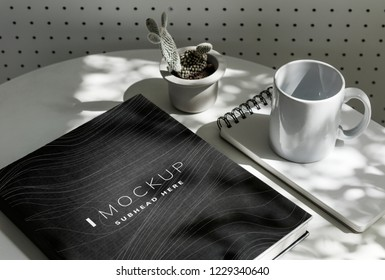 Black textbook cover mockup on a table
