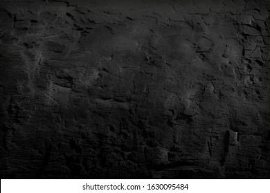 Black textured background. Burnt wood. Wood charcoal