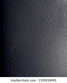 Black textured PU leather background.