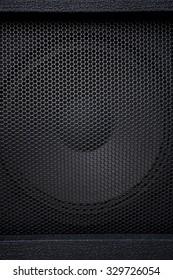Black textured speaker grille background