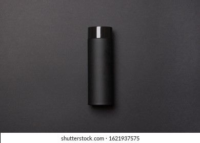 black thermos cup on black background.