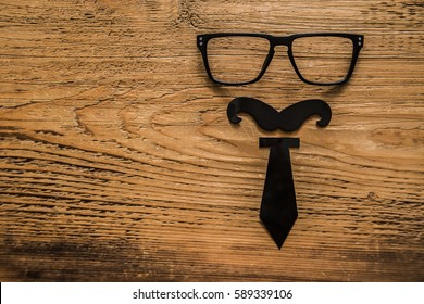 black tie and glasses lie on wooden background with copy space. happy father's day idea, sign, symbol, concept. wood texture background.